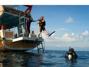 "Taking the ""big step"" off the boat and into the waters of Koh Tao"