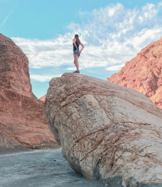 Climbing giant rocks in Death Valley National Park