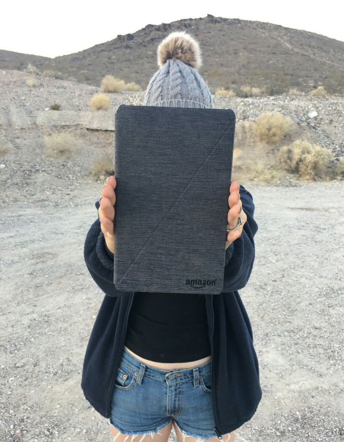 Holding up the Amazon Kindle - the perfect Netflix viewing device while camping