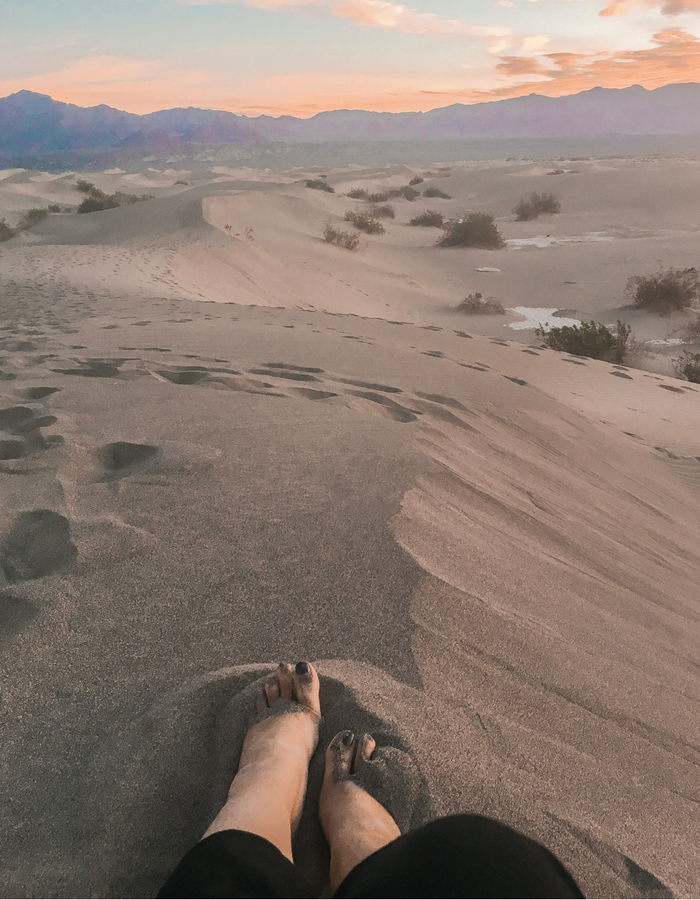 Feet in the sand at Mesquite Sand Dunes for sunrise