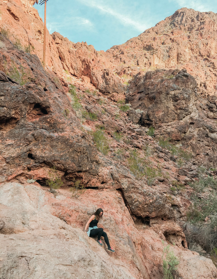 Climbing down some precarious rocks on the trail to Gold Strike Hot Spring