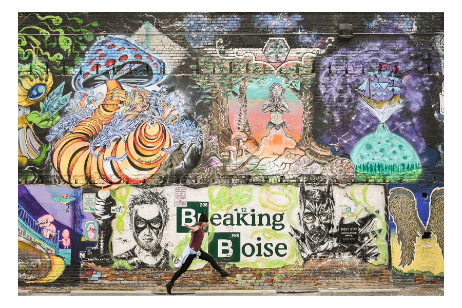 """Leaping next to the famous """"Breaking Boise"""" wall mural"""