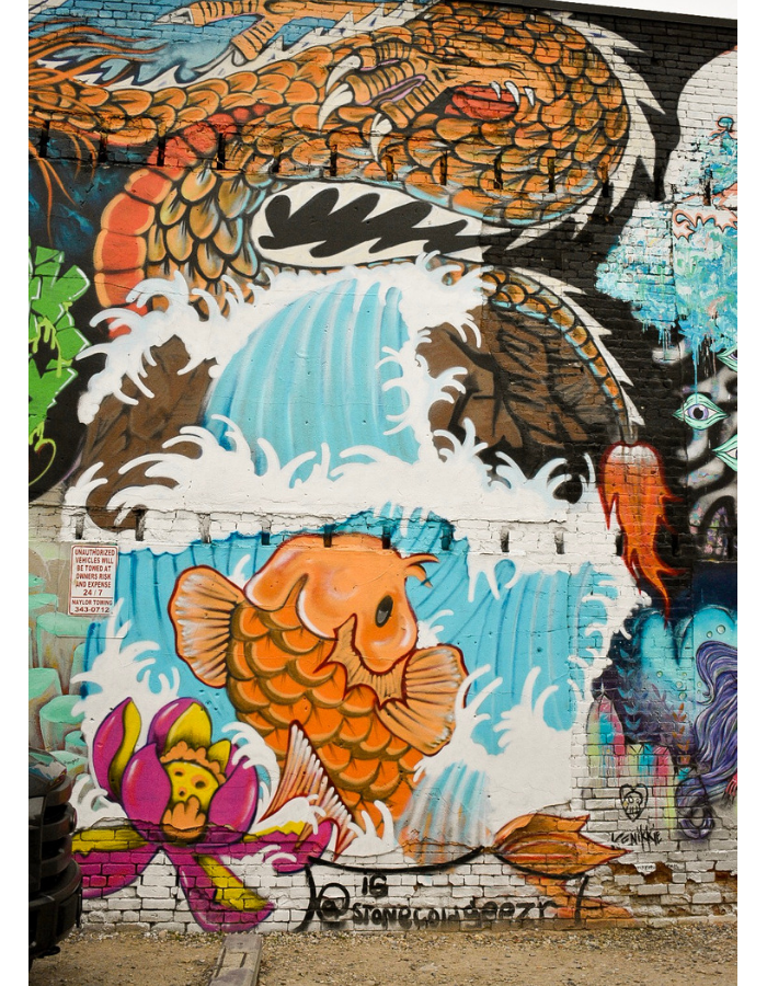 Freak Alley Street Art: A dragon, a koi, and a raging wave